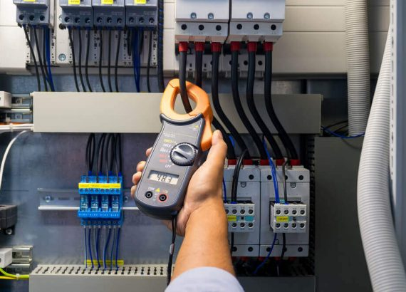 Electrician in Preston tesing commercial power supply unit
